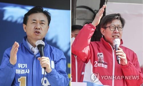 資料圖片:釜山市長候選人金榮春(左)和樸亨埈 韓聯社