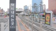 資料圖片:韓10萬計程車司機罷工抵制拼車軟體。