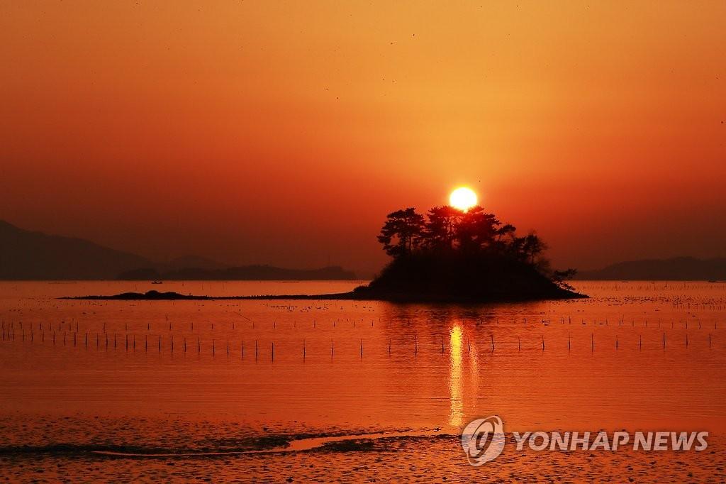 順天灣臥溫海灘的日落 韓聯社