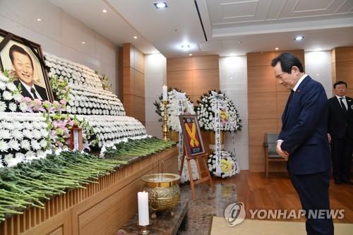 韓總理丁世均弔唁辛格浩