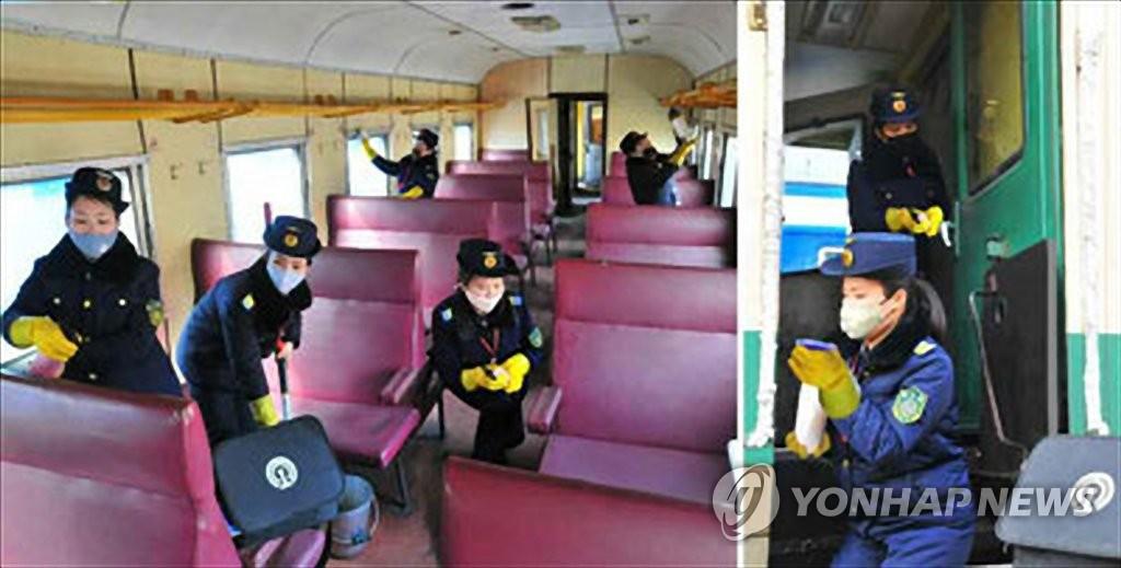 """資料圖片:朝鮮《勞動新聞》2月18日援引""""應急中央人民保健指導委員會""""幹部的話報道稱,截至目前朝鮮沒有出現任何新冠病毒(COVID-19)感染病例。圖為工作人員進行消毒防疫。 韓聯社/《勞動新聞》官網截圖(圖片僅限南韓國內使用,嚴禁轉載複製)"""