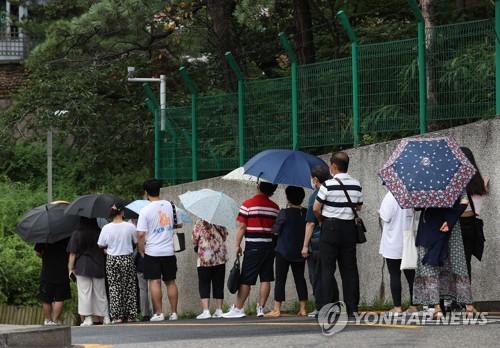 消息:中國明起受理南韓必要人員簽證申請