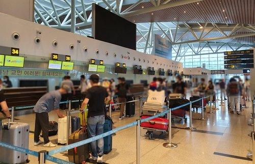 旅越僑民啟程回國