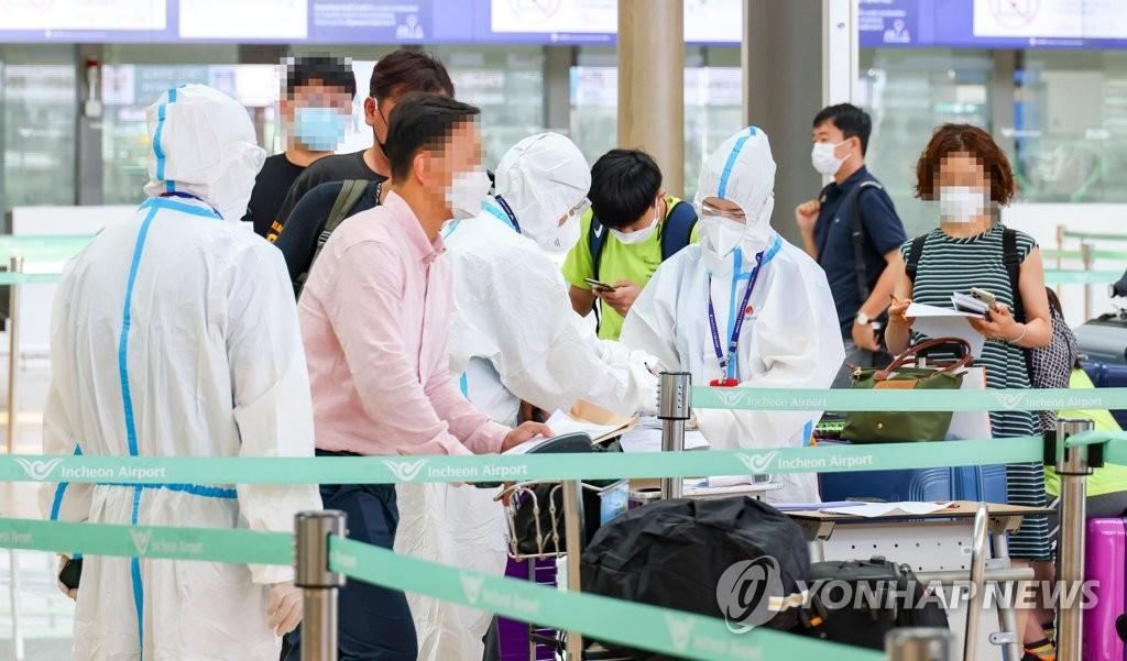 資料圖片:韓企人士經快捷通道赴華。 韓聯社