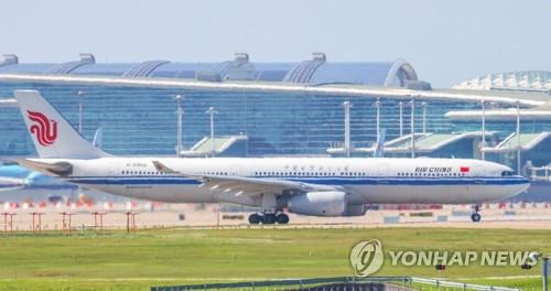 韓增飛大批包機送僑返華