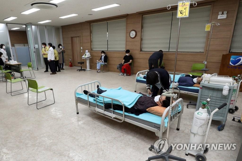資料圖片:阿斯利康疫苗接種現場 韓聯社