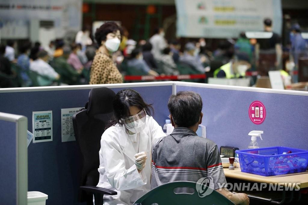 韓首劑新冠疫苗接種者明有望突破1400萬