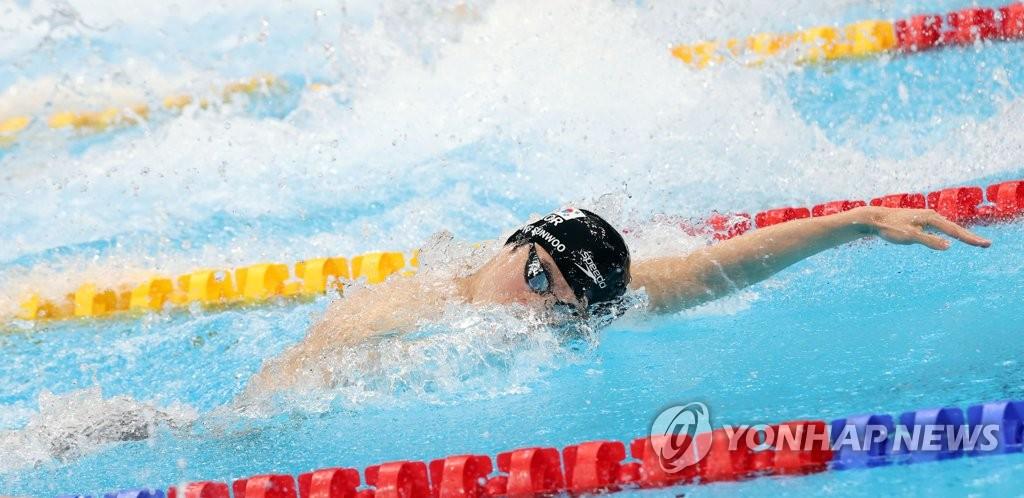 7月28日,在東京水上運動中心,黃宣優參加東京奧運會男子100米自由泳準決賽。 韓聯社